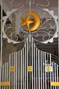 The islamic symbol a gold crescent and star adorns a decorated metal gate leading to the prayer area at the sultan masjid Royalty Free Stock Photography