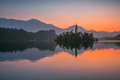 An Island with Church in Bled Lake, Slovenia at Sunrise Royalty Free Stock Photo