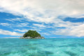Island and crystal clear water at tropical Royalty Free Stock Image