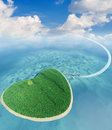 Island in the form of heart and the flying plane Stock Photo