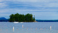 Island getaway private privacy secluded seclusion a small wooded on lake sebago maine with white power boats in front september Stock Photography