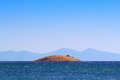 Island in gumuldur interesting marine landscape with a lonely round over greek mountain ridge turkey Royalty Free Stock Photos