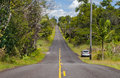 An island highway a bumpy climbing hill among tropical jungle Stock Photo