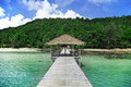 Island location beautiful cambodian pier leading to tropical Stock Photos
