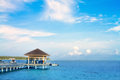 Island in ocean, over water villa with clear sky Royalty Free Stock Photography
