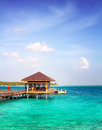 Island in ocean, overwater villa. Maldive Royalty Free Stock Photo