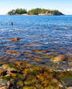 Island off the north coast of lake superior cleart water and an in Royalty Free Stock Image