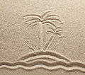 The island with palm trees in the sea is drawn on sand Stock Image