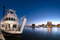 The island queen an evening view of tour ferry against a blue twilight sky and kingston ontario canada waterfront cityscape Royalty Free Stock Photography