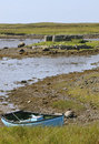 Island with ruined building boat caolas fhlodaigh benbecula outer hebrides Stock Image