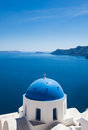 Island view amazing from the cliffs of santorini Royalty Free Stock Photo