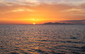 Island view sunset small airplane flying far sky sicily Stock Photo