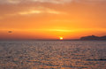 Island view sunset small airplane flying far sky sicily Stock Photography