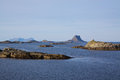 Islets on norwegian coast rocky sunny summer day near lofoten islands Royalty Free Stock Photos