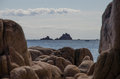 Isola dell ogliastra sardinia islands near santa maria navarrese with rocks out of focus in the foreground Royalty Free Stock Image
