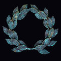 Isolate metal wreath of forged leaves with patina and rust on a the black background Stock Photo