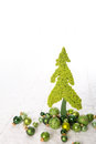 Isolated apple green christmas tree of felt decorated with balls Royalty Free Stock Photo