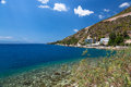 Isolated bay in aegean cliffs. Loutraki, Greece.