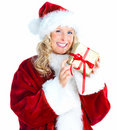 Isolated Beautiful female Santa holding a gift Royalty Free Stock Photo