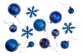 Isolated blue christmas baubles in different sizes and designs snowflake balls Royalty Free Stock Photography