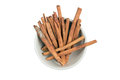 Isolated a bowl of cinnamon stick Royalty Free Stock Photo