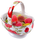 Isolated bunch of jelly candies in a porcelain basket Royalty Free Stock Photo
