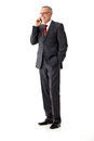 Isolated business senior man, standing and calling Royalty Free Stock Photo