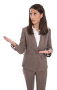 Isolated business woman presenting new product with hands wearing brown suit Stock Images