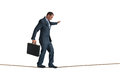 Isolated businessman balancing tightrope on a on white Royalty Free Stock Photos