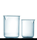 Isolated chemical plastic beakers on table with a small reflection studio shot Stock Images