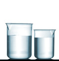 Isolated chemical plastic beakers on table with solution a small reflection and studio shot Stock Photography