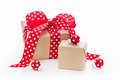 Isolated christmas presents wrapped in paper with red dots a dotted polka ribbon Stock Photo