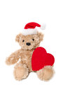 Isolated christmas teddy bear with a red heart Royalty Free Stock Photo