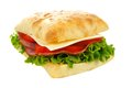 Isolated ciabatta sandwich with ham tomato lettuce and cheese Stock Image