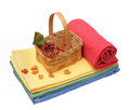 Isolated colorful towels and dried rose Royalty Free Stock Photo