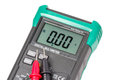 Isolated digital multimeter and probes Royalty Free Stock Photo