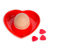 Isolated egg in a red heart-shaped eggcup Stock Photos