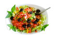 Isolated fresh plain salad garnished with mint sprigs of containing lettuce tomato sweet peppers and black olives served in a bowl Royalty Free Stock Photo
