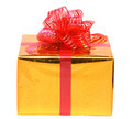 Isolated gift box in the gold package with red bow Royalty Free Stock Photo