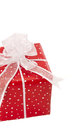 Isolated giftbox wrapped in dotted red paper festive and classic Royalty Free Stock Images