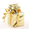 Isolated golden present Royalty Free Stock Photo