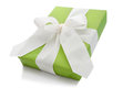 Isolated green gift box tied with white ribbon for Christmas Royalty Free Stock Photo