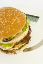 Isolated HUGE burger on scales Royalty Free Stock Photos