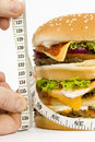 Isolated HUGE burger on scales Stock Photo