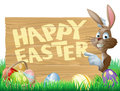 Isolated illustration cute happy easter bunny pointing message reading happy easter Royalty Free Stock Photo