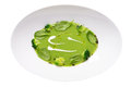 Isolated image of green pea soup with broccoli and cream pattern Royalty Free Stock Photo