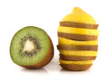 Isolated lemon and kiwi slices tower half kiwi of of fresh diet fruits healthy fruit with vitamins Royalty Free Stock Image