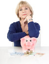 Isolated mature woman with piggy bank on white Royalty Free Stock Photos