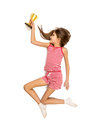 Isolated photo of happy girl running with golden trophy cup Royalty Free Stock Photo