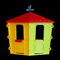 Isolated plastic children s playhouse the on black background Royalty Free Stock Photo
